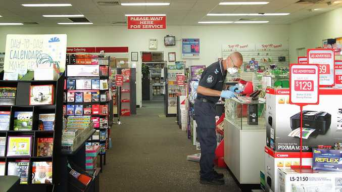 Scenes of crime investigate a break-in at Australia Post in Central Avenue.