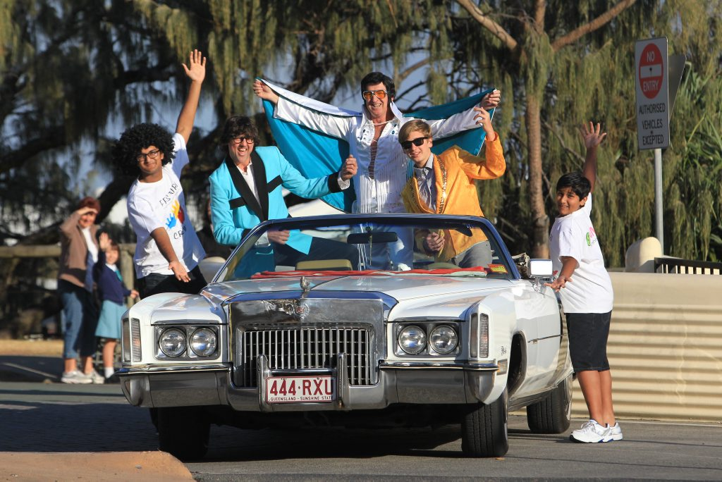 Twilight steet parade preview at Kings Beach Fringe Festival. (L to R) Sharath Mammen, Jason 'Buddy Holly' Robertson, Johnny 'Elvis' Fogwell, Matt Fogwell and Hrithik George with a 1972 Cadillac Eldorado.