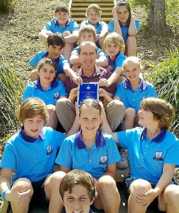 TOP TEACHER: Greg Flint with students from his 5/6 St John's class.