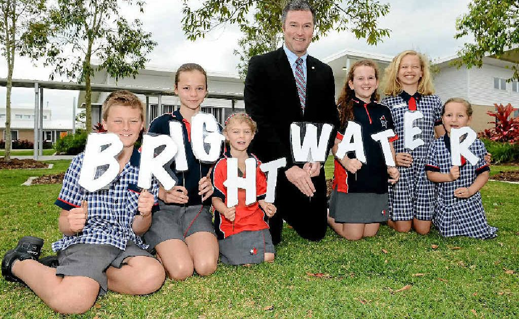 Education Minister John-Paul Langbroek opens Brightwater State School with Tyrone Jones, Molly Timpsom, Molly Beucher, Eloise Goldsmith, Emma Landra and Eva Laing.