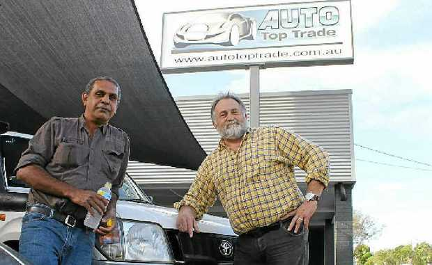 COMMUNITY SPIRIT: Marty Clapps (right) and David Saunders from Auto Top Trade come to the rescue for the Bundjalung Warriors.