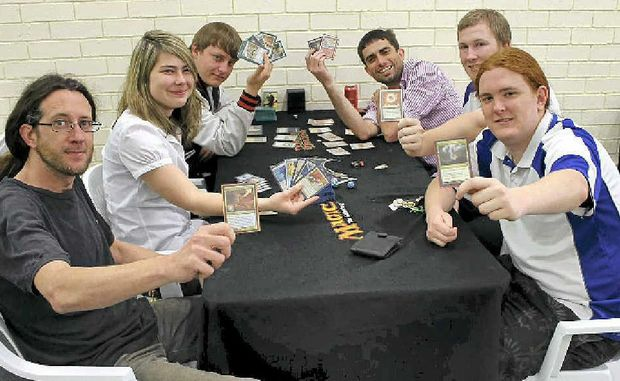 AFICIONADOS: Enjoying a game of Magic are Kevin McGlashan, Kimberley Armstrong, Christopher McKinnon, Graeme Rooke, Sean Crain and Liam Fraser-Quick.