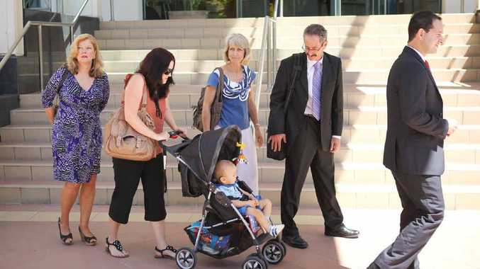 Jenny Diefenbach (second from left) leaves the Rockhampton courthouse with (from left) her mother Margaret Kimmorley, her son Noah, her parents-in-law Lyn and Ken Diefenbach, and Maurice Blackburn Lawyers principal Gino Andrieri.