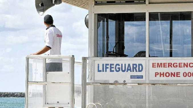 A Sunshine Coast Council lifeguard keeps watch over Mooloolaba Beach.