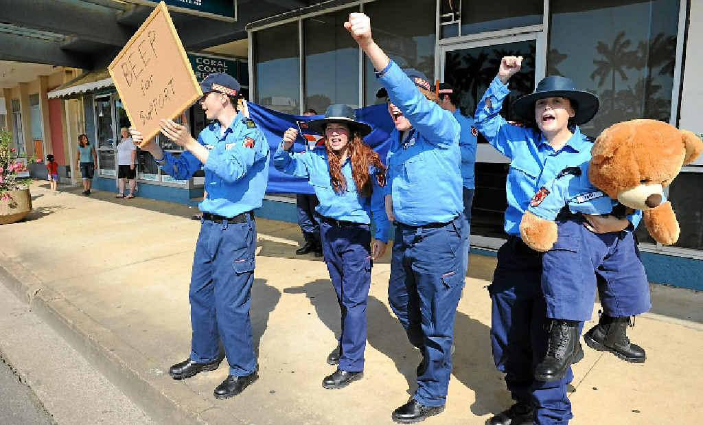 Emergency Service cadets Greg Walker, Melody McNamara, Casey Nankavill, Caitlin Simpkins and Tedd-E Bear (a registered cadet) protest outside Minister Jack Dempsey's office in Bundaberg.