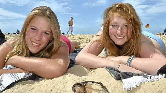 Rexa Thomsen-Delefs and Annabelle Geissler enjoy the weather on Maroochydore Beach.