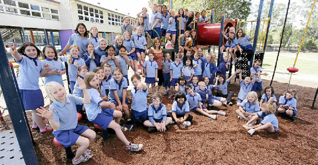 Nambour State School kids relax after shooting their music video clip. They were lined up in the shape of Australia.