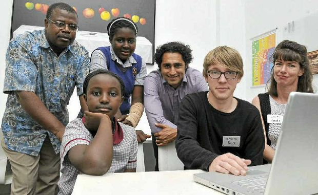 From left front, Confiance Nzaramba, 11, Trent Newton, and Amelia Ahern. From back left, Sibo Nzaramba, Janine Nzaramba, 13, and Leandro Mendes.