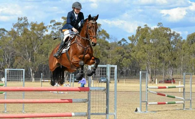 ELEVATION: Jessica Forbes on New Zealand-bred horse Georgetown in the showjumping phase of one-star eventing at this month's Gallagher Triequathon at Morgan Park.