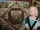 """Carnival of Flowers 2012. Quilting Exhibition, Robyn Ginn with her quilt """"Trees on the Village Green"""". Photo: Bev Lacey / The Chronicle"""