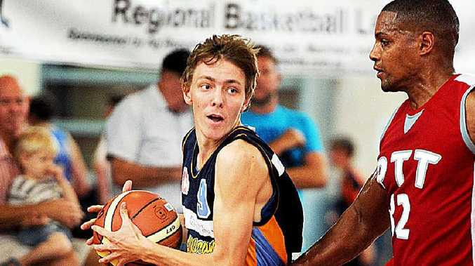 Hervey Bay's Trevor Sauvageot goes to the hoop against Protech in round two of the Regional Basketball League.