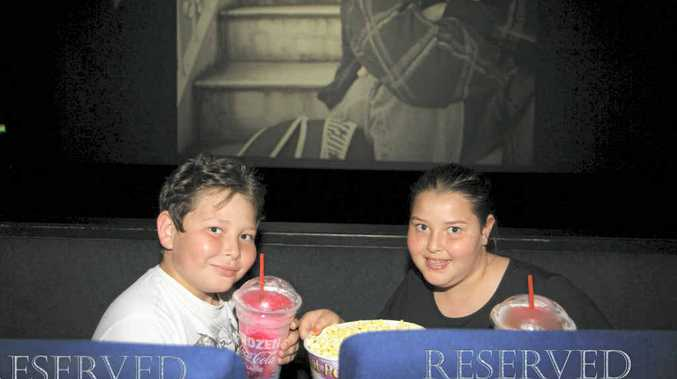 Excited to be heading to the movies on the school holidays, Northview State School students Xander Contor, 11, and Shameeka Contor, 9, take their numbered seats at Mount Pleasant Cinemas.