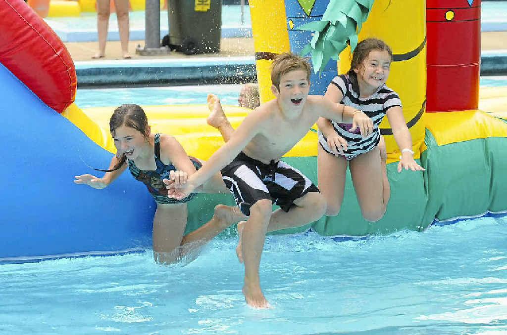 Holly Giudice, Cambel Jones-Giudice and Summer Giudice enjoy the warm weather at the Anzac Pool.