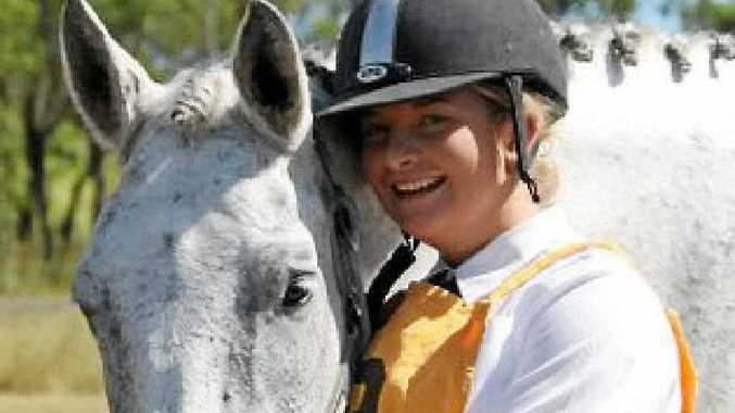 """Dany Iker with her """"pride and joy"""" mare Adelphi."""