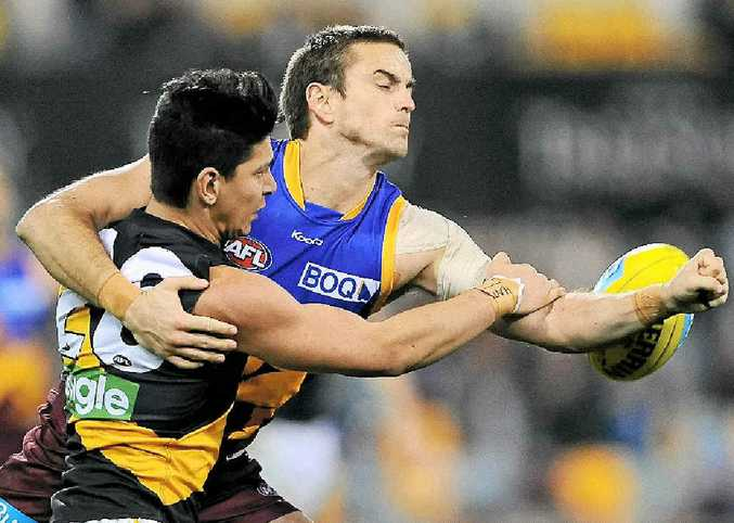Brisbane's Josh Drummond and Richmond's Robin Nahas contest possession on August 4.
