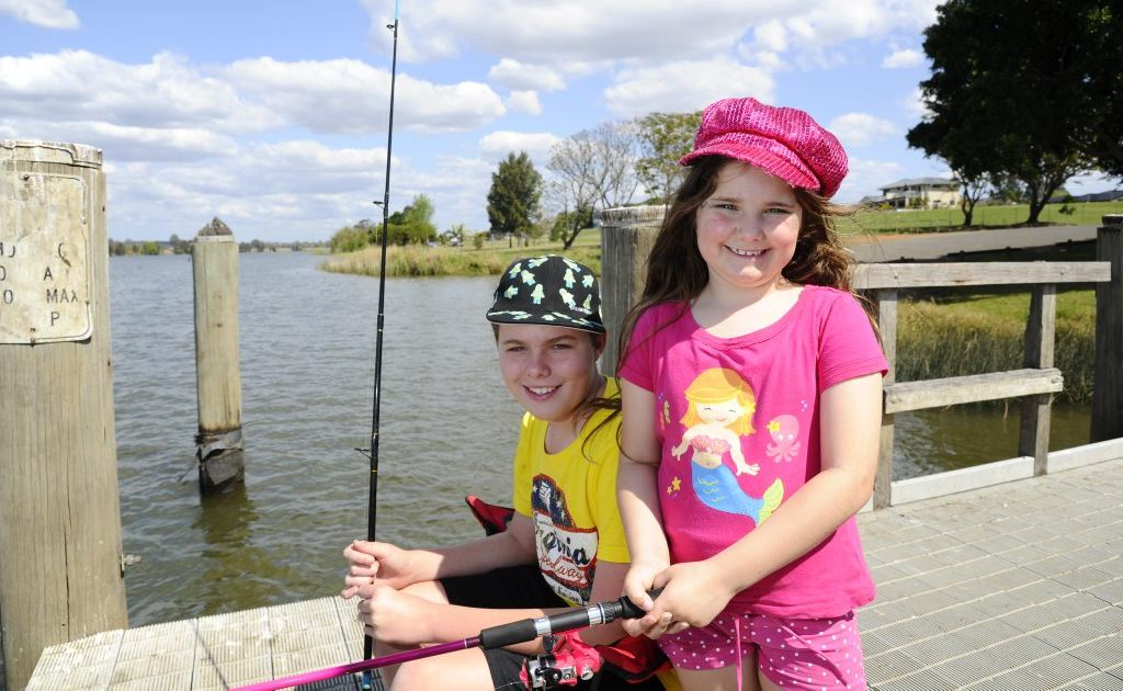 Brother and sister Brayden, 13, and Brigette, 6, Jamieson were fishing off the wharf at Corcoran Park on Saturday. Photo JoJo Newby / The Daily Examiner