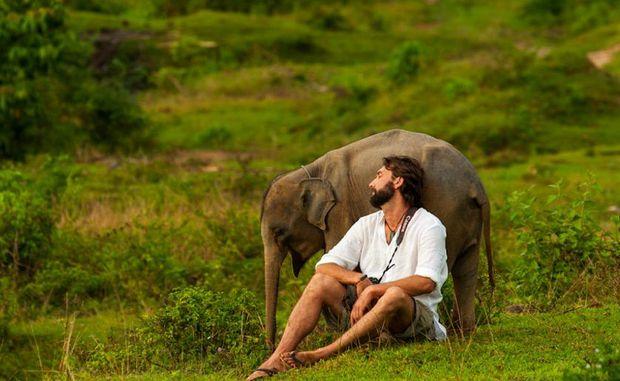 Murray Munro with Bona the baby elephant.