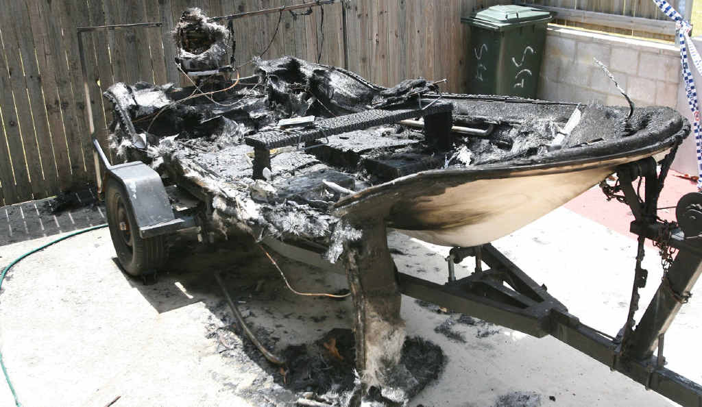 Police are investigating if this burnt-out fibreglass boat on Ann St, Rockhampton, was deliberately lit.