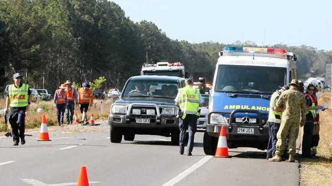 The scene of a two-car fatal accident on the Bruce Highway, just before Roys Road.