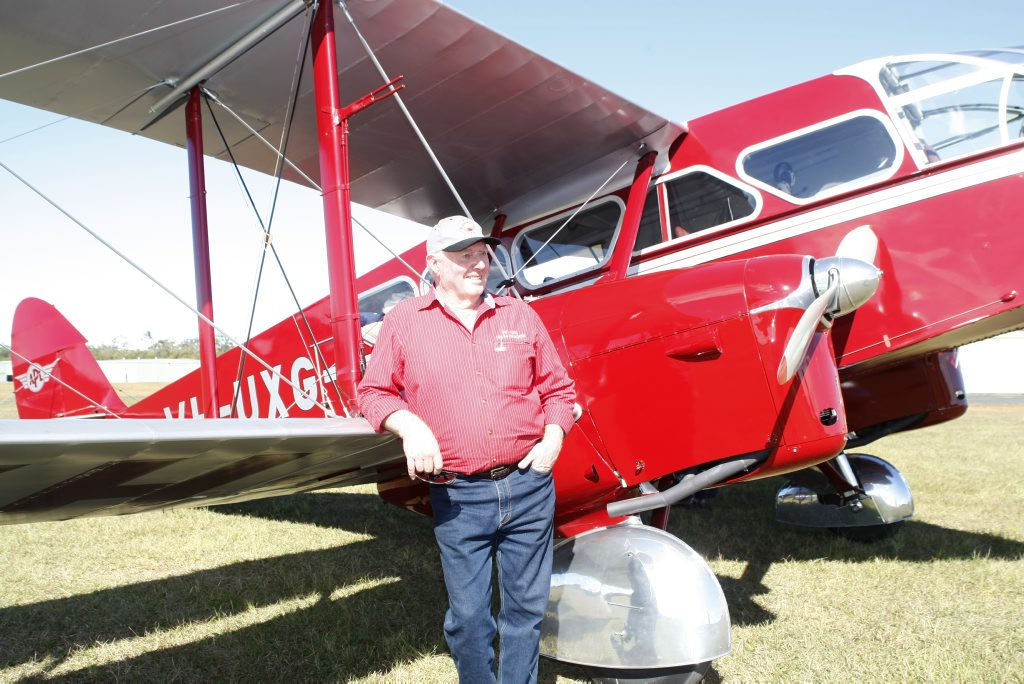 Des Porter with the restored bi-plane which was used in the 1930s by the Royal Flying Doctor Service, it is one of only four in the world. Photo: Nicola Brander / Caboolture News.