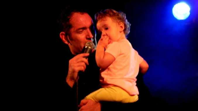 Darren Percival brought up one of his own children to join his show at the Caloundra Music Festival.