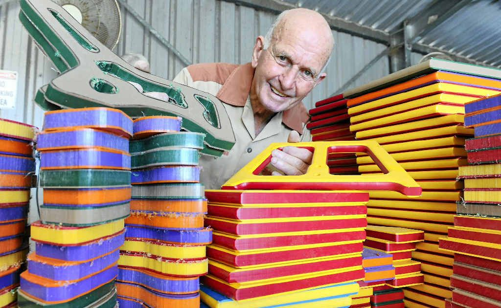 Ernie Nankivell with rough-cut plastic used to manufacture toys for sick children.