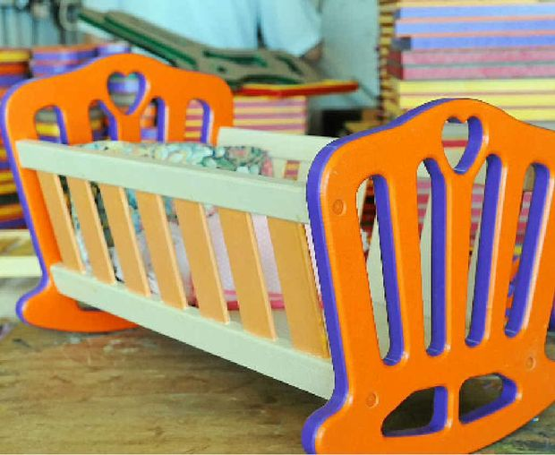 An assembled cradle in the toy shed.
