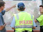 Locals discuss terrain with police at the Kenilworth Showgrounds forward control base on Tuesday.