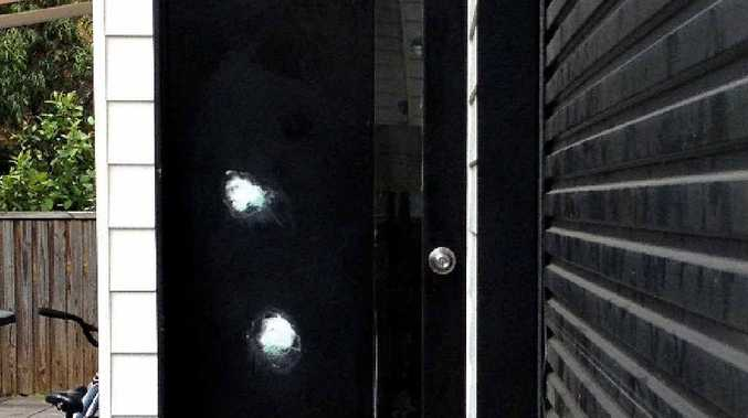 Two bullet holes in a unit door had been patched yesterday.