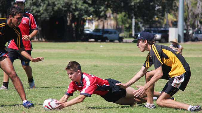 Ben Townsend makes a try when he competes at the North Queensland junior touch trials in Townsville. He was representing the Under-16 boys touch team from Mackay.