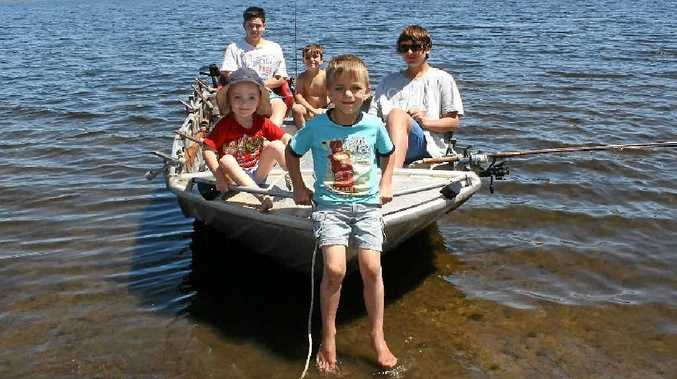 Chilling in their boat at Leslie Dam are (front) Jasmine and Toby Smith and (back) Brodie Andreas, Justin Smith and Jordan Utz.
