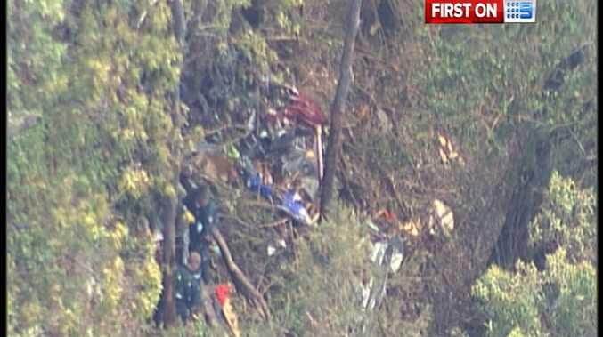 AGL rescue crew at the scene of the plane wreckage near Imbil. There were no survivors.