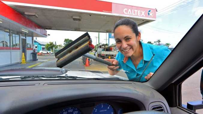 Walker St Caltex will be holding a service day on Saturdays starting the 13th to raise money for charities, owner Jayde Devlin gets in some practice.