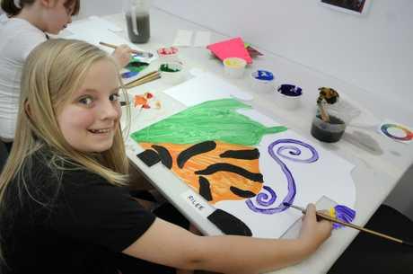 Rilee Prebensen enjoys an art class.