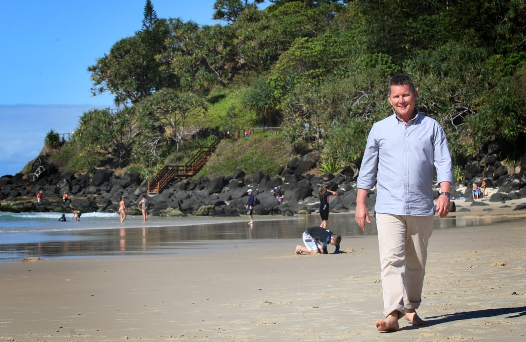 Image for sale: Tom Burlinson enjoying the beach at Greenmount.