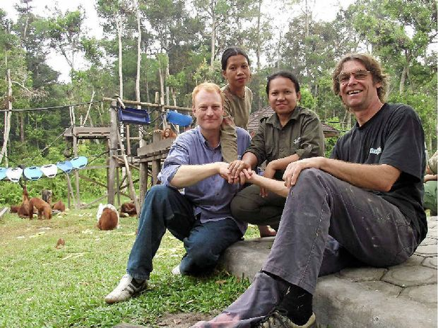 WILD MEN: Keith Bolton (left) and Nik Hyde (right) with some of the staff at the Nyaru Menteng orangutan sanctuary in Borneo.