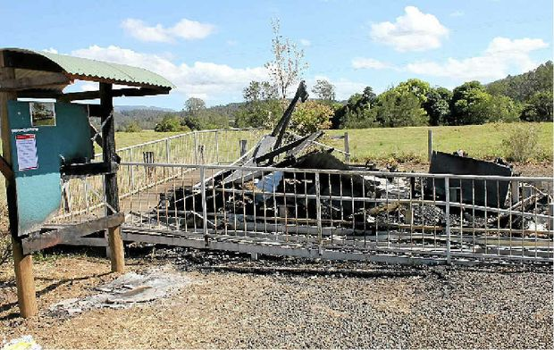 PASSPORTS BURNED: The Terry family from Larnook (from left) Tia, Jasper, Elliott and Francis lost mail in the Rock Valley Post Office fire.INSET: All that remains...