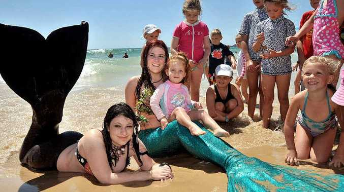 Mermaids Aradia (left) and Nerissa swam ashore at Mooloolaba beach to help Australian Conservation Foundation Healthy Oceans campaigner Chris Smyth get the Aus Govt to commit to its plan to establish the world's largest network of marine reserves.