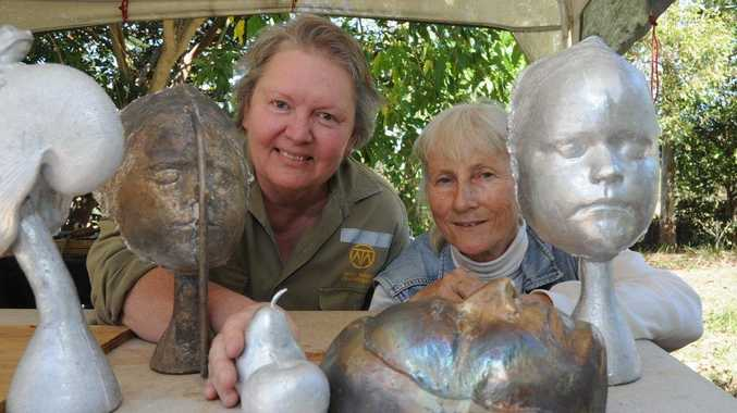 Bronze sculptors Kerry Calson and Monika Bayer show off some of the group's new work.