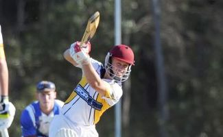 KABOOM: Bushrangers batsman Tony Andrews belts one past a Past Grammars bowler. Photo: Valerie Horton