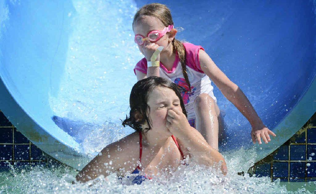 SPLISH SPLASH: Jayde Brown, 8 and Jorja Foley, 7 brace themselves at the Grafton Aquatic Centre