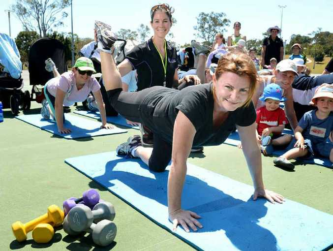 Mother of two Lisa Harris with personal trainer from Envy This Body Diane McKendrick and other women who are taking part in the boot camp for mums and bubs designed to help women expecting a baby or those who have recently given birth keep fit.