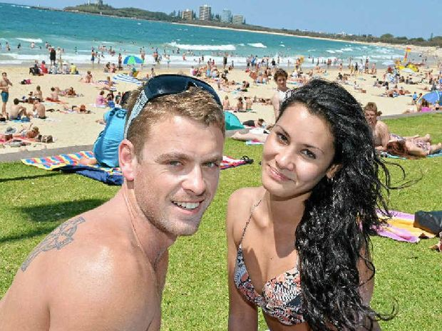Mark Biggs and Rose Green enjoy the sun and sand at Mooloolaba Beach for Family Fun Day.