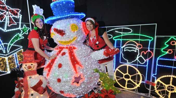 Melany Brock, left, Monique Williames ( both correct) from Christmas Complete at Minyama, with their Christmas light display. Photo: Brett Wortman / Sunshine Coast Daily