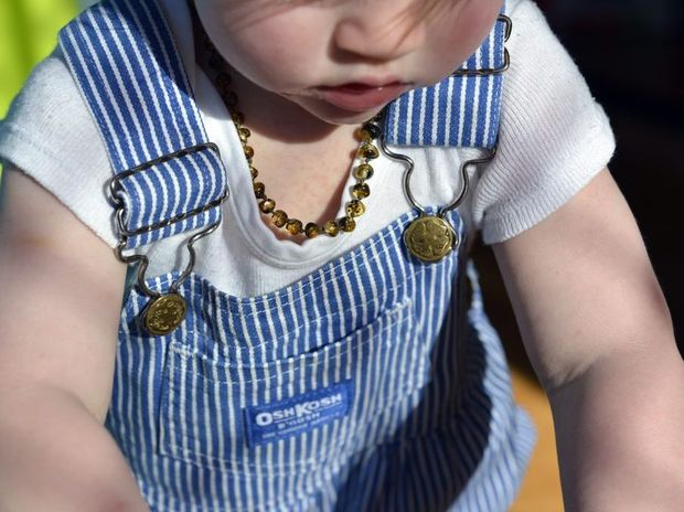 Amber teething necklaces may be a danger to babies and young children despite the reported health benefits.