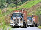 SCENIC: A convoy climbs into the majestic PNG highlands.