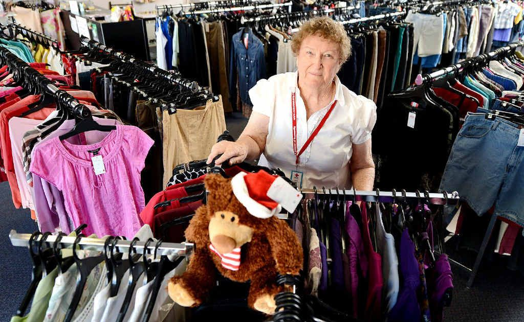Red Cross volunteer Gloria Snell sorts items at the North Ipswich store.