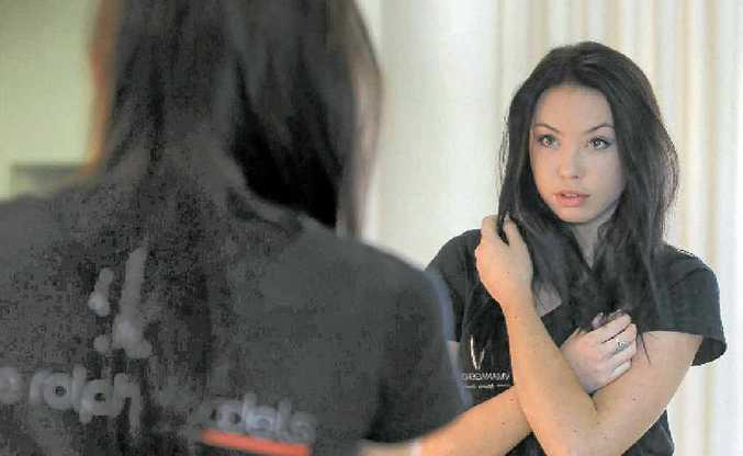 ON REFLECTION: Faye Rolph Models coordinator Jade Salangsang looks into a mirror.
