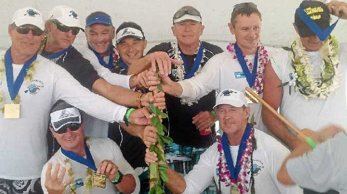 Mooloolaba Outrigger Canoe Club crew members celebrate after their world senior masters title win at the Molokai Hoe race in Hawaii yesterday.