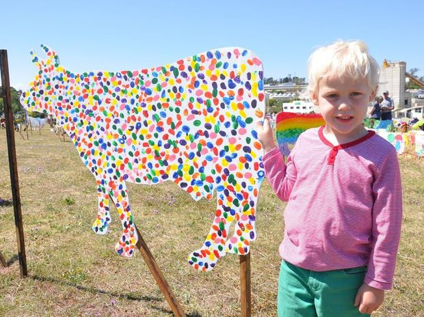 Will Sieber checks out the cow art. Photo Laura Hunt.